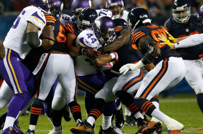 Minnesota Vikings running back Matt Asiata (44) is stopped by the Chicago Bears defense during the first half of an NFL football game in Chicago, Monday, Oct. 31, 2016. (AP Photo/Nam Y. Huh)